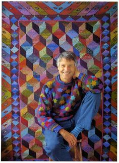 Kaffe Fassett Quilt. I recreated as best I could. I only have 2.5 borders left to knit. Almost 20 years after I started! http://archives.citypaper.net/images/articles/2010/04/08/agenda_cap-1.jpg