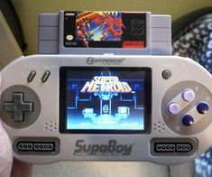 Portable Super Nintendo Player - The Supaboy is a handheld Super Nintendo device. You can simply plug in an SNES game into the console and begin playing some of your old favorites. There are also 2 ports for external Super Nintendo Controllers.