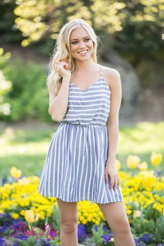 We adore this sweet striped dress! Featuring a vintage looking pattern of off-white and blue stripes, this dress simply channels the days of summer at a seaside carnival or festival! The low cut detail back and x-shaped spaghetti straps adds some drama to the look, while a gentle v-neckline and elastic waistband help make it comfortable!