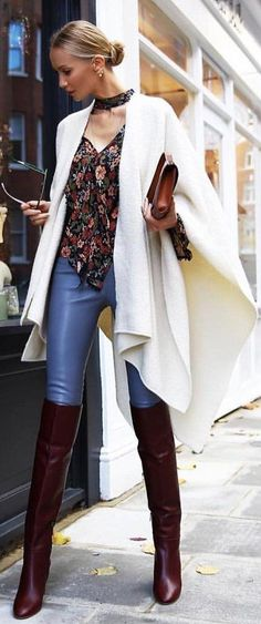#winter #fashion / White Poncho / Printed Blouse / Blue Leggings / Leather OTK Boots