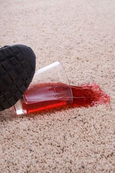 removing ancient stains from carpets with cleaning solution plus an iron and clean towel (Oxy-Clean also works wonders)