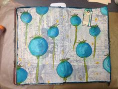 """Inky Obsessions : """"first journal page I did in it. I love poppies and the poppy pods. Any my favorite Golden's Fluid Cobalt Teal seemed like the way to go for my first page! I adhered some of the Tim Holtz tissue roll, then some Golden's Airbrush Paint in white over that. Some oil pastels to finish off the shading, and my water brushes with Dylusions Ink for the stems and the spikey parts."""""""
