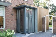 A timber clad extension creates a new relationship between a brick semi-detached house and its green surrounding - CAANdesign Porch Extension, House Extension Design, House Design, House Cladding, Timber Cladding, Porch Timber, Sas Entree, Glass Porch, Front Porch Design