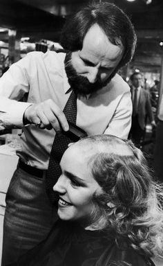 A woman having her hair shaved off in the 1980s