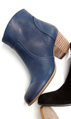 Comfy ankle booties with an easy side zipper, rounded toe and oh-so-walkable stacked heel.