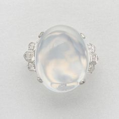 18K WHITE GOLD, MOONSTONE AND DIAMOND RING 1 moonstone and 12 diamonds approx 20.0 x 16.1 mm & 1.25 cts