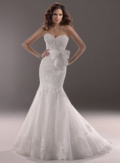 """Designer: Maggie Sottero Wedding Dresses  """"Liv""""  Description: Capture drama in this stunning fit and flare gown of Alencon lace with a strapless, sweetheart neckline and detachable bow belt. Finished zipper over inner corset back closure. Division: Haute Couture  $1498.00"""