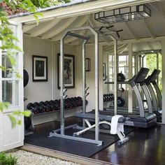 Outdoor garage gym with really cool door for feeling like you're working out outside. Dream home gym decor: dream home garage gym design. Home Gym Garage, Basement Gym, Crossfit Garage Gym, Dream Garage, Dream Home Gym, Gym Room At Home, Home Gyms, Home Gym Decor, Home Gym Design