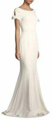 04609cb1f4d Badgley Mischka Peek-A-Boo-Sleeve Trumpet Gown Striking gown in mermaid  silhouette with tied cap sleeve shoulder details. Peek-a-boo cap sleeves.