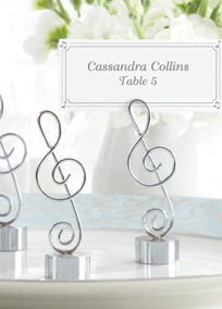 """Table number holder with peacock feather added???....if music be the food of love, playwonderful reason to favor your guests with Love Songs Place Card/Photo Holder, Kate Aspen's tribute to the harmonies that have become the heart and soul of romance--and our lives. Features and facts: Silver-finish, metal musical clef with sturdy base and slot at the top for place card or photo. Coordinated place card with musical notes in four corners included Favor measures 3"""" h x 1"""" w. Sold in a set of…"""