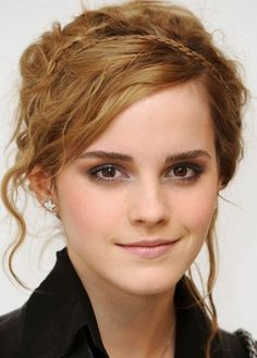Emma Watson Braided Hairstyle: Teeny-tiny crown braids