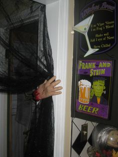Dollar store hand holding back curtains so you can walk through.. Just put nail in to hold to wall and put blood coming out of where nail is in hand...