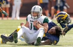 Dru Brown Photos - Rashan Gary of the Michigan Wolverines loses his helmet while tackling Dru Brown of the Hawaii Warriors during the third quarter on September 2016 at Michigan Stadium in Ann Arbor, Michigan. Michigan won the game - Hawaii v Michigan Michigan Wolverines, Ann Arbor, College Football, Football Helmets, Alabama, Tennessee, Hawaii, Warriors, Conference