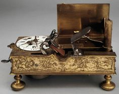 18th Century alarm clock. When the alarm goes on a flintlock is fired which lights a spring loaded candle. On display at the British Museum.