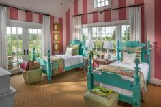 "A design full of spunk and energy, the kids' bedroom diverts from the norm with a blend of fun vibrant hues and bold striped walls to deliver a definite wow factor. ""We were looking at preppy colors, and the hot bright pastels were sort of the beginning of this room,"" says interior designer Linda Woodrum."