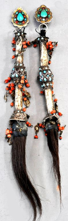 One of my favorite pr of earrings made from braid ornaments from Khiva. Gilt silver , turquoise with coral, and hair. (Designed by Linda Pastorino private collection )