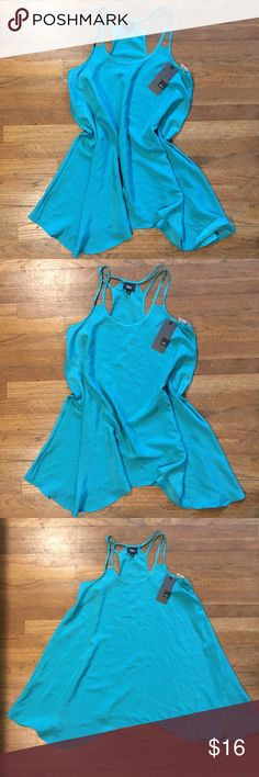 """NWT Teal Flowing Strappy Dressy Tunic Tank Top A beautiful flowy teal tank with strap accents. Inverse U shaped cut bottom adds to flow. A Chiffon-like flowy material. Perfect layering piece! Size S but could fit a M or L depending on Chest size, see measurements: Flat lay measurements across: Chest: 17"""" Length: 32"""" average. I ship same or next day! Mossimo Supply Co Tops Tank Tops"""