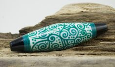alive glass teal bicone by: ali vandegrift