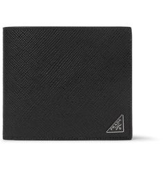 Make a smart impression when settling the bill with Prada's black billfold wallet. Designed with a dark-grey interior for cool contrast, it's been expertly crafted in Italy from pebble-grain leather and has plenty of slots, pockets and sleeves to house your resources.