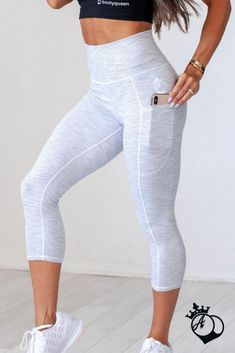 "Cropped version of our customer favorite, best selling White Stripe legging. This must-have comfort crop gives you a sleek design, deep pockets on each side, and an ultra high ""muffin top"" preventing seamless waistband. Wear High waisted for a smooth silh"