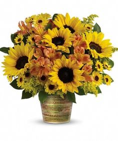 Grand Sunshine Bouquet, Send the warmth of fall sunshine with the Grand Sunshine Bouquet!  Nothing brightens a fall day like a warm mix of sunflowers, alstroemeria, viking pompons and solidago arrangement in a ceramic cachepot, a magnificent, multi-glazed pot in rich shades of green.  http://www.veldkampsflowers.com/product.cfm?iteID=3259