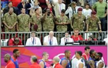 117d: It's obvious that the bodies of the athletes are either cropped out or the photo was intentionally taken to emphasize the British military officials in the stands. The caption for this one was interesting because it was about the British military helping out the French, which highlights international unity. The British soldiers appear to be looking down at the athletes, making them almost look like guardian angels.