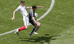 Gary Cahill, left, and Hal Robson Kanu tussle.