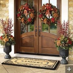 double wreaths for Fall with matching planters, love the front door by debbie.rose.37