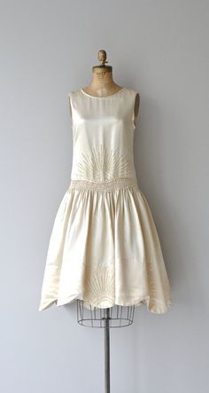 Vintage 1920s luminous ivory silk dress with piped trim, ivory sunburst beaded dropped waist above wide ruched band, full skirt with scalloped and