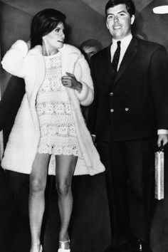 For her second marriage (she was married to James Welch from 1959 to Raquel Welch wore a sexy crochet dress for her February 1967 Paris wedding to Hollywood producer Patrick Curtis. She teamed her dress with a three-quarter length white fur coat. Famous Wedding Dresses, Celebrity Wedding Dresses, Wedding Dress Pictures, Beautiful Wedding Gowns, Celebrity Weddings, 1960s Wedding Dresses, Celebrity Couples, Wedding Icon, Dream Wedding