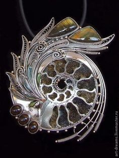 Not wire wrapping, but filigree. I don't think I've ever seen a more masterful and beautiful incorporation of pyritized ammonite into jewelry.