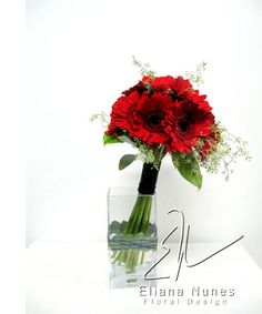 bridesmaids bouquets red gerber daisy with black eyes accented with seeded eucalyptus/  volusiacountyweddings/ www.callaraesfloralevents.com