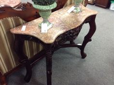 Hall Table - Oriental influence with a granite top.  40 inches wide.  Item  1438-1. Price $250.00    - http://takeitorleaveit.co/2017/01/06/hall-table-5/