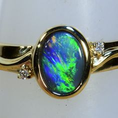 Timeless elegance. This Solid black opal & diamond engagement ring is a ring you will want to wear forever Hand Made Solid 18k yellow gold  14481a
