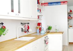 White kitchen, wooden countertops and a mix of open and closed shelving   live from IKEA FAMILY