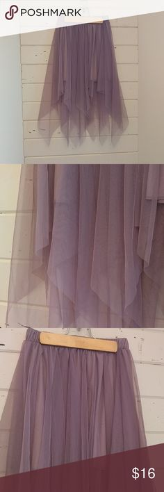 Purple tulle  jagged edge skirt NWT This is such a cool skirt, it could be a fairy skirt or as I have it shown in an example office wear. Lavender color Rue21 Skirts
