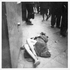 Warsaw, Poland, A woman dying in the ghetto street. In the album there are photographs taken in Poland and the USSR in Some of the Warsaw Ghetto photos are identical to photos in the Joest collection.