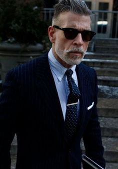 Blue shirt with navy suit and white pocket square