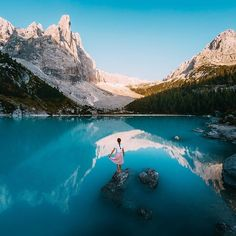 Photo of the Day: @sarahpour adds to the beauty of Lago di Sorapis in South Tyrol. Captured by #GoProFamily member @marcbaechtold using #HERO5 Black's RAW Photo format. • • • @GoProIT #GoProIT #SouthTyrol #GoProTravel #GetOutside