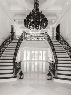 A grand double staircase with custom iron railing a. A grand double staircase with custom iron railing and marble floors be Luxury Staircase, Double Staircase, Modern Staircase, Staircase Design, Modern Entryway, Grand Staircase, Dream Home Design, My Dream Home, House Design