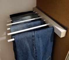 More closet space with a hanging rack