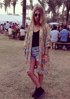 Harriet Stewart from Elle UK spotted wearing Ganni Gardenia Sequin Kimono at Coachella. Get your Ganni for the upcoming festival season on www.iluvjj.com