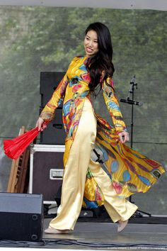 PRAGUE, CZECH REPUBLIC - MAY 25: A model from Vietnam showcases traditional Vietnamese clothing during the fashion show of migrants as part of the multicultural festival Refufest 2013 at the Kampa Island on May 25, 2013 in Prague, Czech Republic.