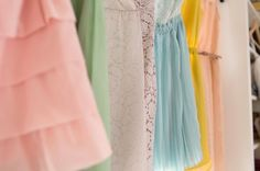 a lineup of bridesmaids dresses with a penchant for color  Photography by weheartphotography.com