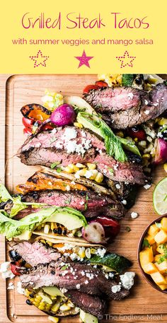 These CRAZY delicious Grilled Steak Tacos are the ultimate summer BBQ recipe. Inspired by Mexican carne asada, the steak is marinated till flavorful and tender then grilled over high heat so the outside is charred and the inside remains pink. The tacos are piled high with steak and grilled summer veggies for an easy to make and healthy dinner recipe that everyone will love. | theendlessmeal.com | woodcuttingboards.com