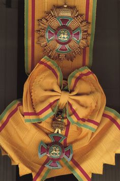 """The Order of Emperor Menelik II was founded in 1924 by the Regent, Ras Tafari Makonnen, during the reign of Empress Zauditu, and is one of the most attractive of the Imperial Orders. It is also sometimes referred to as """"The Order of the Lion of Judah"""" or as """"The Order of the Ethiopian Lion""""; indeed, these names appear to have applied to what was essentially one comprehensive honour. In 1996, the Crown Council decided to end this anomaly by establishing two separate Orders with distinct…"""