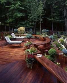 Wooden deck design.  like the bench seating along one side.