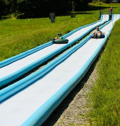 Racing down our Summer Tubing track! Open weekends for fun into the fall season!