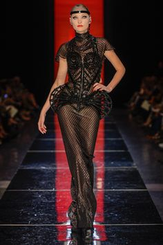8.Crinoline Side Supports:Jean Paul Gaultier Fall 2012 Couture Collection. Gaultier exhibits the condensed precursor form of the crinoline skirt. He modernizes the under structure by taking off the fabric overlay.