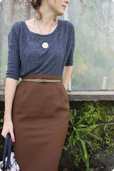 Loose heather grey 3/4-length sleeve top, brown pencil skirt, skinny belt